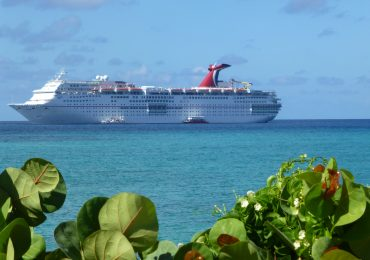 Carnival Ecstasy docked off-shore at Princess Cays